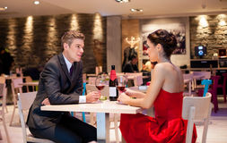 Couple enjoying at the restaurant Royalty Free Stock Photography