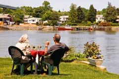 Couple enjoying river view royalty free stock photos