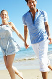 Couple Enjoying Romantic Beach Holiday Stock Image