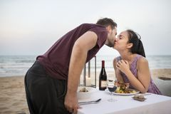 Couple enjoying a romantic dinner at the beach royalty free stock image