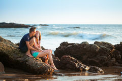 Couple enjoying a romantic evening on the beach at sunset Royalty Free Stock Photo