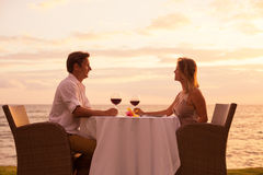 Couple enjoying romantic sunnset dinner Stock Photography