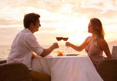 Couple enjoying romantic sunnset dinner Royalty Free Stock Photos