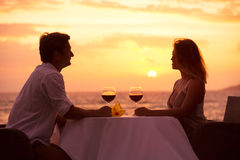 Couple enjoying romantic sunnset dinner Stock Photo