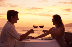 Couple enjoying romantic sunnset dinner Royalty Free Stock Photography