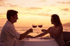Couple enjoying romantic sunnset dinner Royalty Free Stock Photography