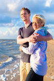 Couple enjoying romantic sunset on beach Stock Photography