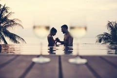 Couple enjoying a romantic sunset royalty free stock photography