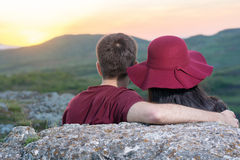 Couple enjoying romantic sunset royalty free stock image