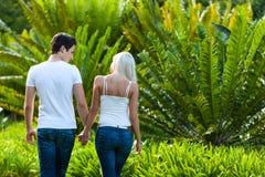 Couple enjoying romantic walk in park. Royalty Free Stock Image