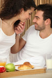 Couple enjoying room service. In their hotel room Royalty Free Stock Photography