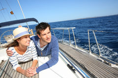 Couple enjoying sailing boat trip Stock Photos