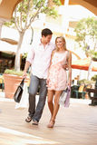 Couple Enjoying Shopping Trip Stock Photos