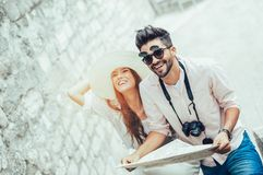 Couple enjoying sightseeing and exploring city. Tourist couple enjoying sightseeing and exploring city Stock Photography