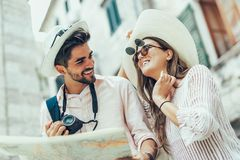 Couple enjoying sightseeing and exploring city. Tourist couple enjoying sightseeing and exploring city Stock Image