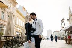 Couple enjoying sightseeing and exploring city. Tourist couple enjoying sightseeing and exploring city Stock Photo