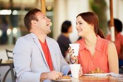 Couple Enjoying Snack In CafŽ Stock Photos