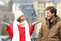Couple enjoying snow in a snowy day Royalty Free Stock Images