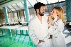 Couple enjoying spa wellness treatments Stock Photos