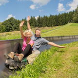Couple Enjoying Summer Sledge Royalty Free Stock Photos