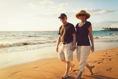 Couple Enjoying Sunset at the Beach. Senior Couple Enjoying Tropical Sunset at the Beach royalty free stock photography