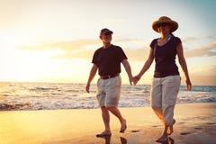 Couple Enjoying Sunset at the Beach. Senior Couple Enjoying Tropical Sunset at the Beach stock photos