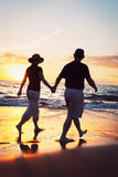 Couple Enjoying Sunset at the Beach Royalty Free Stock Photos