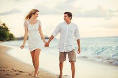 Couple Enjoying Sunset on the Beach. Romantic Couple Enjoying Sunset on Beautiful Tropical Beach Stock Photos