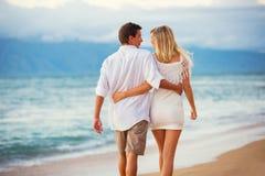 Couple Enjoying Sunset on the Beach Royalty Free Stock Photo