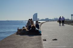 Couple Enjoying Sunshine by the Sea in Barcelona, Spain royalty free stock photography