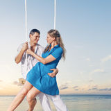 Couple enjoying swing Royalty Free Stock Images