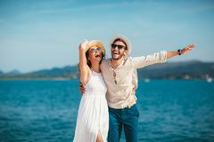Free Couple Enjoying The Summer Time By The Sea. Stock Photography - 119585062