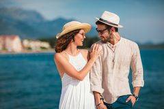 Free Couple Enjoying The Summer Time By The Sea. Royalty Free Stock Images - 119585199