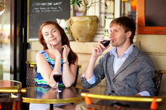 Couple enjoying their glasses of red wine Stock Photos