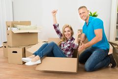 Couple Enjoying In Their New Home Stock Image