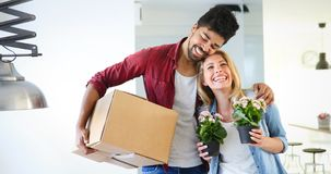 Couple enjoying their new luxurious home. And hugging in living room royalty free stock photography