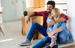Couple enjoying their new luxurious home. And hugging in living room stock image