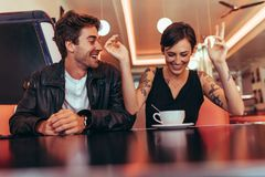 Couple enjoying their time over a coffee at a diner Stock Images