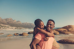 Couple enjoying themselves at the beach stock photos