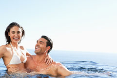Couple enjoying time together in the pool Stock Image