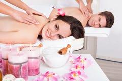 Couple Enjoying Tissue Back Massage Stock Images