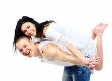 Couple enjoying together while piggyback ride Royalty Free Stock Image