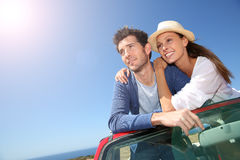 Couple enjoying trip in cabriolet stock photo