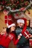 Couple enjoying under the Christmas tree Royalty Free Stock Photos