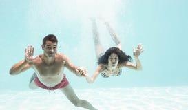 Couple enjoying underwater in swimming pool Royalty Free Stock Photo