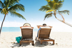 Couple Enjoying Vacation On Beach Royalty Free Stock Photo