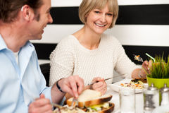 Couple enjoying vegetarian and healthy breakfast Stock Photos