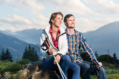 Couple enjoying view hiking in the mountains Stock Photo