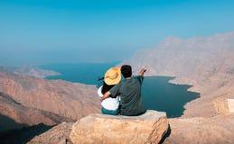 Free Couple Enjoying View Of Fjord Khor Najd In Musandam Oman Royalty Free Stock Photography - 162770767
