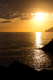 Couple enjoying the view of the sunset from Manarola, Cinque Ter Royalty Free Stock Images
